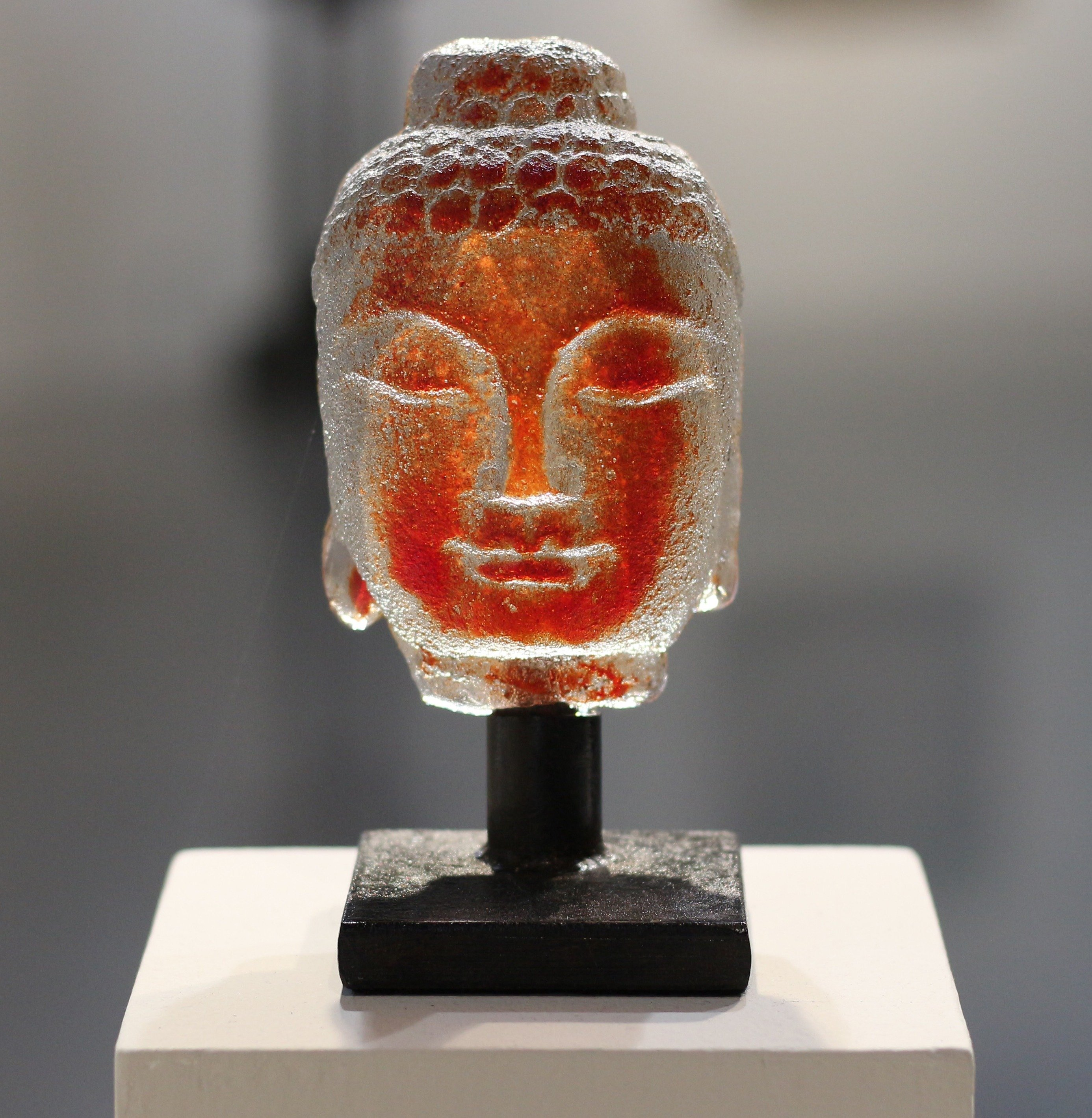 Sand cast glass with steel stand Tiny Buddha in Roma Red by Marlene Rose